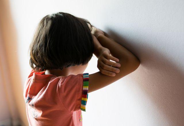 sad children,girl standing at room